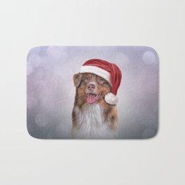 Dog Australian Shepherd in red hat of Santa Claus Bath Mat