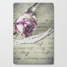 love letter with pearls and rose Cutting Board