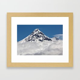 Stunning snowy top of rocky volcanoes cones above clouds. Beautiful mountain landscape of Kamchatka Framed Art Print