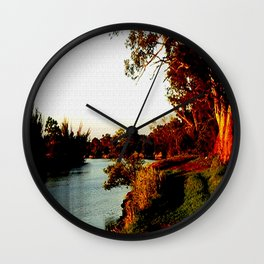 Sunsets on the river bank gum Trees Wall Clock