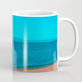 stony beach with mountains in the background Coffee Mug
