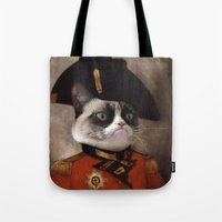 general Tote Bags featuring Angry cat. Grumpy General Cat.  by UiNi
