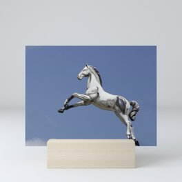 Escaped carousel horse Mini Art Print