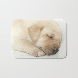 Sleeping labrador puppy Bath Mat