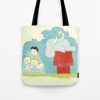 peanuts Tote Bags featuring Elephants Love Peanuts by Teo Zirinis