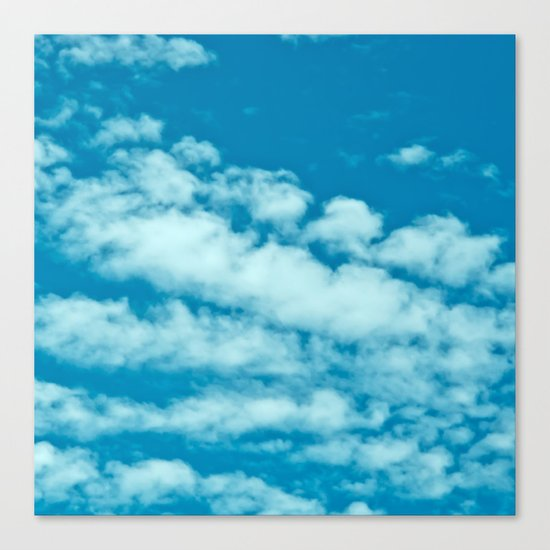 Beautiful blue sky and fluffy clouds Canvas Print