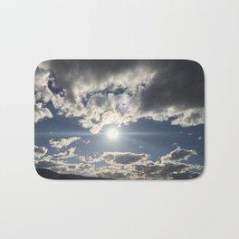 Sun glare in the beautiful cloudy sky Bath Mat