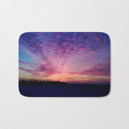 Chasing the clouds Bath Mat