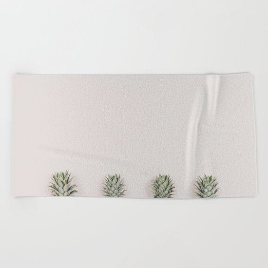 Pineapples in a Row Beach Towel