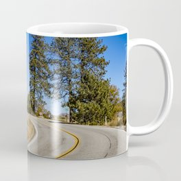 Empty Highway Road Cutting through Pine Trees and Golden Meadow in Lake Cuyamaca Coffee Mug