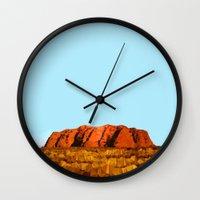 polygon Wall Clocks featuring uluru polygon by Matthias Hennig
