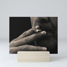 the smoker Mini Art Print