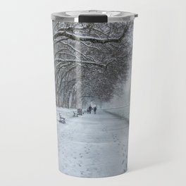 Leaving footprints under the cold freezing snow by the Lake Annecy in France Travel Mug