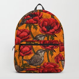 Wrens in a red anemone garden     Backpack