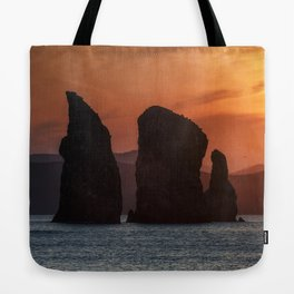 Beautiful seascape - Three Brothers Rocks in Pacific Ocean at sunset Tote Bag