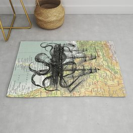 Octopus Attacks Ship on map background Rug