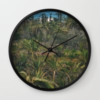 oasis Wall Clocks featuring Oasis. by calvin./CHANCE