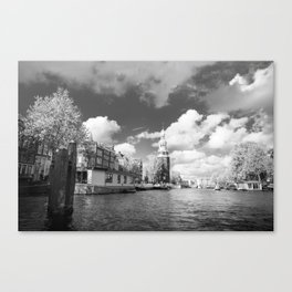 Montelbaan tower on the banks of canal Oudeschans in Amsterdam, Netherlands Canvas Print