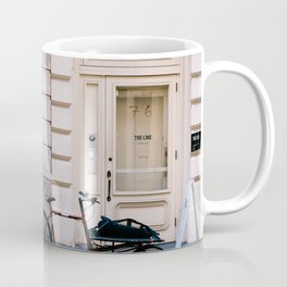 Old bicycle parked at luxury fashion store in New York Coffee Mug