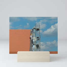 The painter on the rooftop Mini Art Print