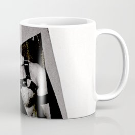 S/he may be a saint or a vixen Coffee Mug