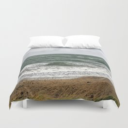 Land and sea under stormy clouds Duvet Cover