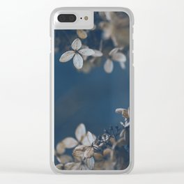 White Floral Pattern Against Blue Background Clear iPhone Case