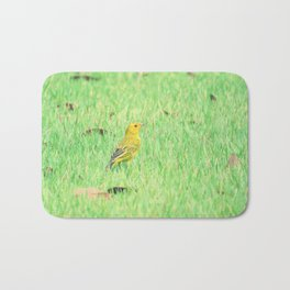 Yellow canary in grass Bath Mat