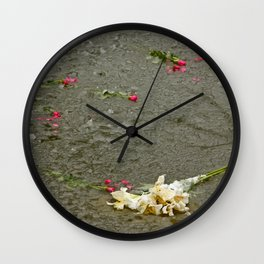 Flowers in a frozen pond Wall Clock
