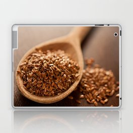 Brown flax seeds heap on wooden spoon Laptop & iPad Skin