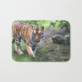 Tiger is walking in the woods Bath Mat