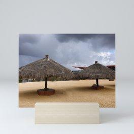 Empty beach due to incoming rain storm Mini Art Print