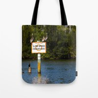 manatee Tote Bags featuring Manatee Zone by Roger Wedegis