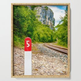Railway pole sign close-up with number five along railroad track Serving Tray