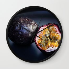 Halved Passion fruit on black plate Wall Clock