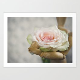 Wood mannequin with a rose Art Print