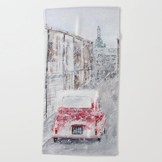 Snowfall and little red car Beach Towel