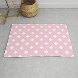 White Swiss Cross Pattern on Pink background Rug