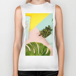 Succulents on pastel colors background. Flat lay, copy space Biker Tank
