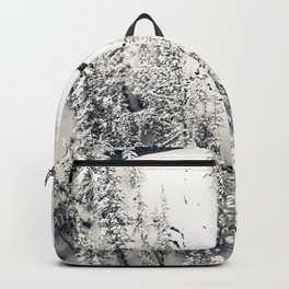 Snow on Textures of Pine Trees and Cliffs Backpack