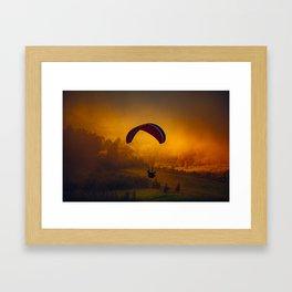 Paraglider Flying Around Orange Clouds Framed Art Print