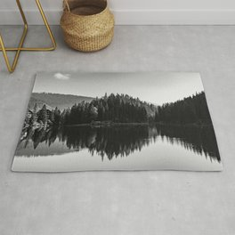 Black and white image of Lake Braies and its reflections Rug