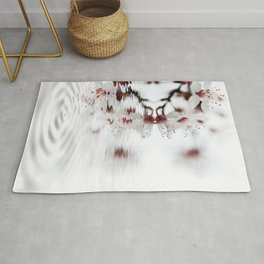 white cherry blossom and water reflection Rug