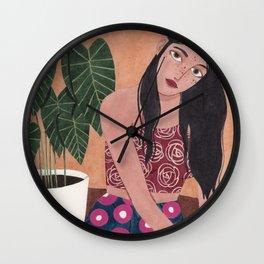 Sitting on the floor Wall Clock