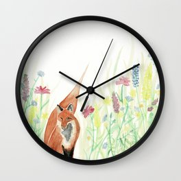 Fox in the wildflowers Wall Clock