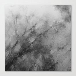 Rain splashing on tree reflection in lake surface. Norfolk, UK.  Canvas Print