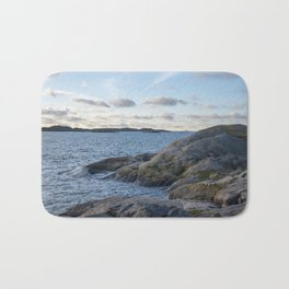 Craggy coastline by the ocean Bath Mat