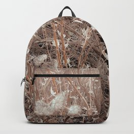 blooming dry plant with brown dry grass field abstract background Backpack