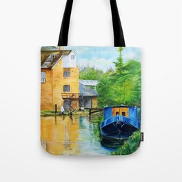 A narrow boat stops after passing through Coxes Lock near Addlestone in Surrey.  Tote Bag