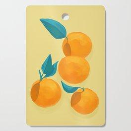 Oranges on yellow Cutting Board